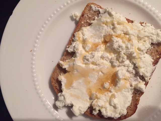 Di Palo's handmade ricotta on toast with honey.