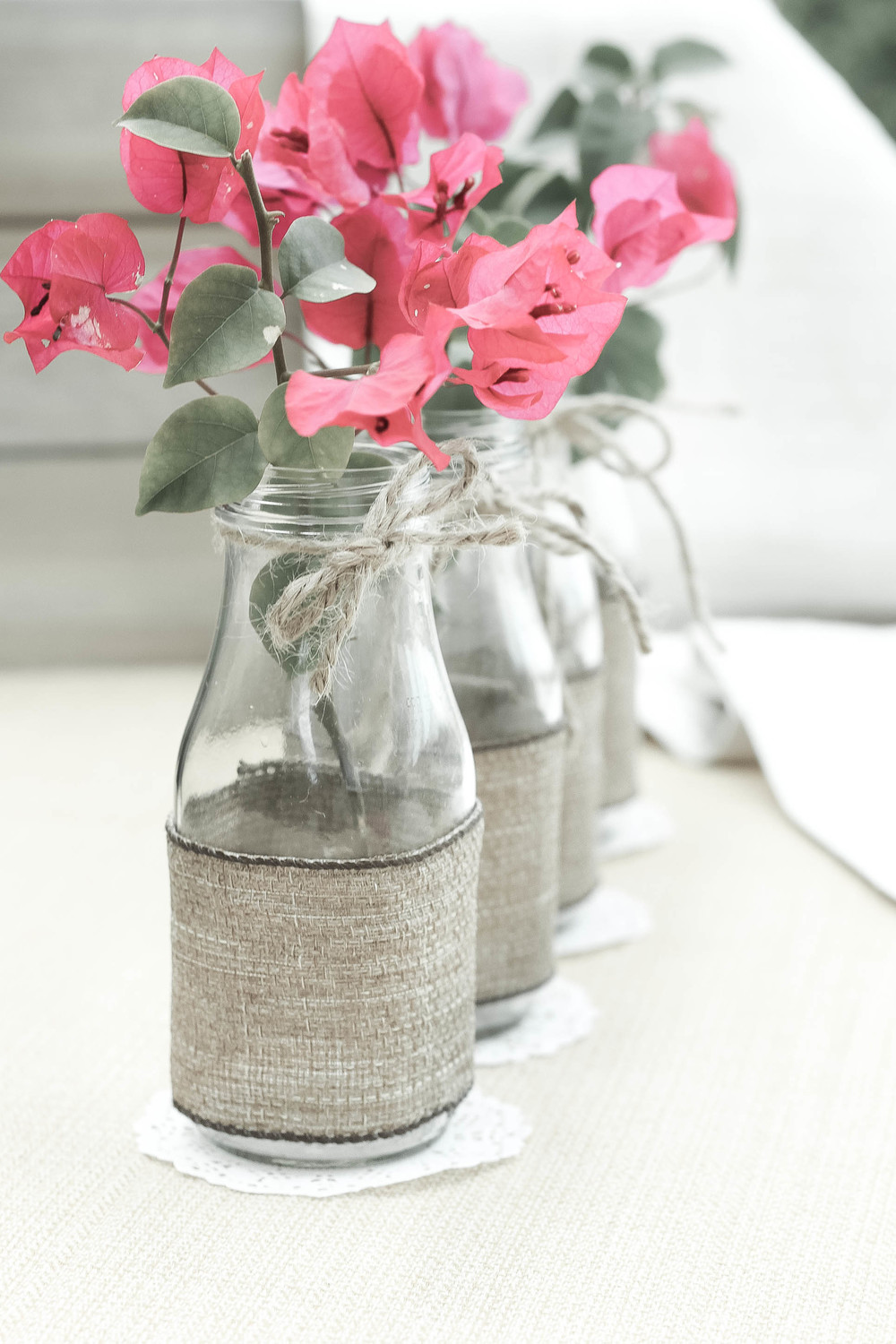 Diy recycle glass bottles into flower vases the party preppers recycled glasses flower vases party decorations reviewsmspy