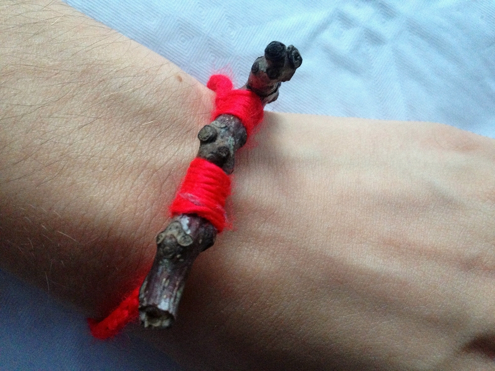 Bracelet made from a walnut twig and crocheted into place.