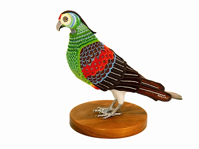 Laurel Roth Hope,  Paradise Parrot , 2012, crocheted yarn, hand carved pigeon mannequin, walnut stand, 8 x 9 x 14 inches.