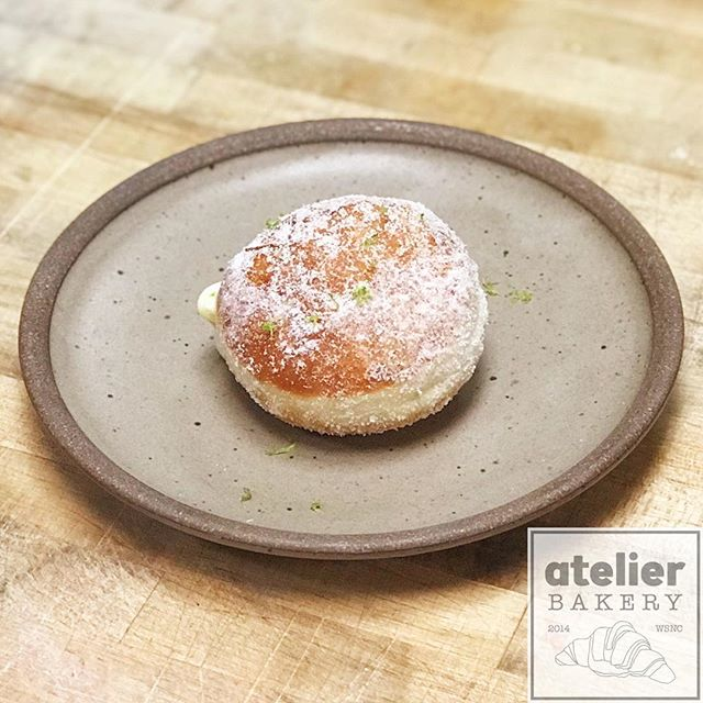 Bomboloni 😎 (doughnuts) . . When a member of your kitchen team asks for practice rolling dough balls ... you make doughnuts. These are filled with our tongue-tingling lime and basil curd. 😍 . .  Atelier Bakery 8am until 2pm Tuesday through Sunday (always closed on Mondays) . . #happysaturday #doughnuts #bomboloni #limeandbasil #france #paris #cruffin #bestintown #traditional #darkchocolate #best #croissant #onlyatatelier #wsnc #winstagram #dailyphoto #winstonsalem #myws #downtown #downtownwinston #foodie #shoplocal #sweet #delicious #desserts #love #beautiful #food #yummy #photooftheday