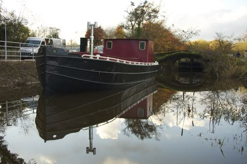 Reflections: Boat being refurbished for future tourism