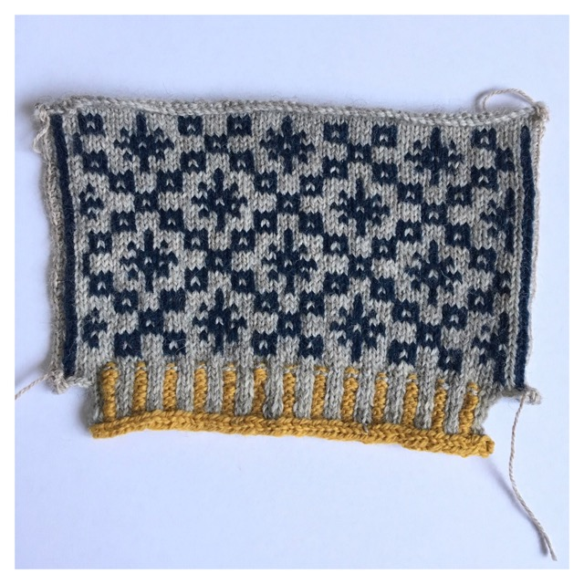 Updated to show what happened after I reinforced the steek stitches and cut through the striped rows of my knitting. I will have to do this on the neck of The Oa to open it up. I survived cutting my knitting!