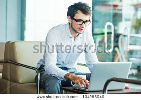 stock-photo-businessman-sitting-in-cafe-134263049.jpg