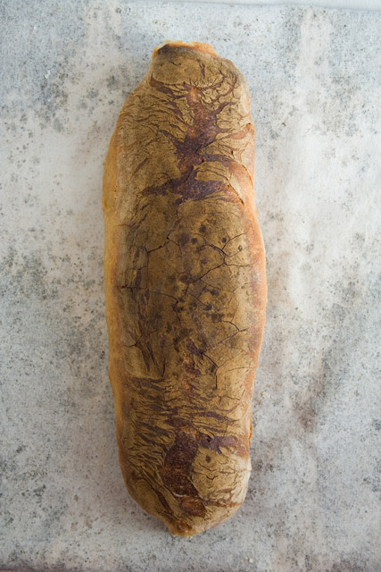 FILONE   Large, tube-shaped loaf, baked dark to very dark, generously coated with wheat bran; open, irregular crumb structure and waxy-looking webbing. Mature fermentation; because of the unique baking method, flavor is nutty and sour with a slightly bitter aftertaste.