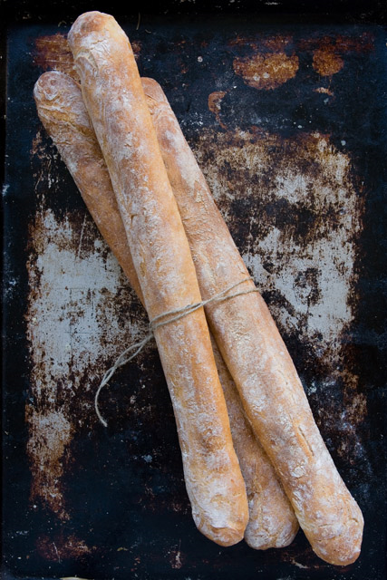STIRATO Long, baguette-shaped loaf with a light brown crust and open, irregular crumb structure. Sour, nutty aftertaste.