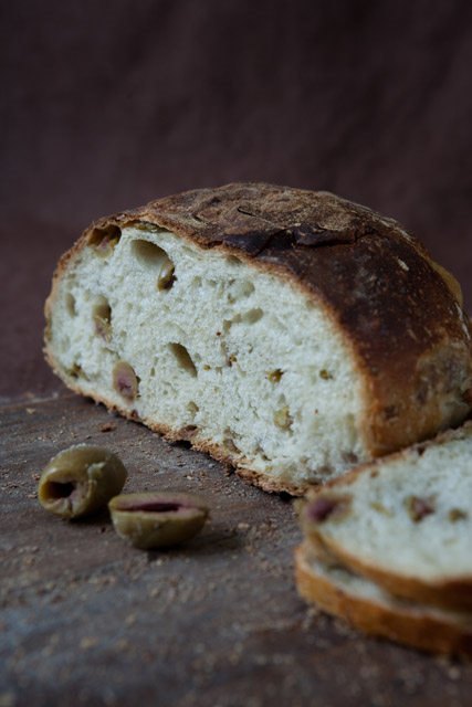 TRUCCIO DONI   Small oval loaf with a golden brown crust and an open, airy crumb with large pieces of green olive. Slightly sour with an intense olive flavor.
