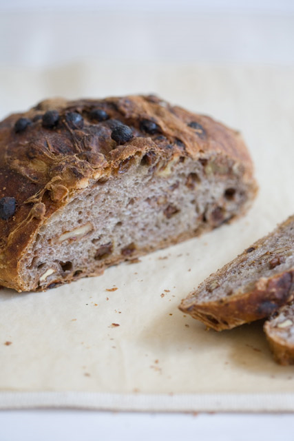 TRUCCIO SANTI Small oval loaf with a dark chestnut-colored crust and medium crumb structure; loaded with walnuts and raisins. It's finished with a touch of black pepper and cinnamon to enhance the nutty flavor.