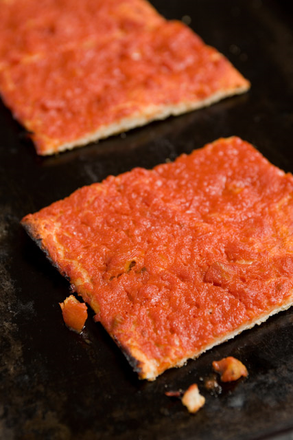 PIZZA POMODORO    Tomato, olive oil, and salt; thin, crisp crust with slightly burned edges.