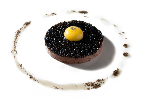 Veal tartare, quail egg, toasted brioche, and truffle 'caviar' by chef Mark Pensa