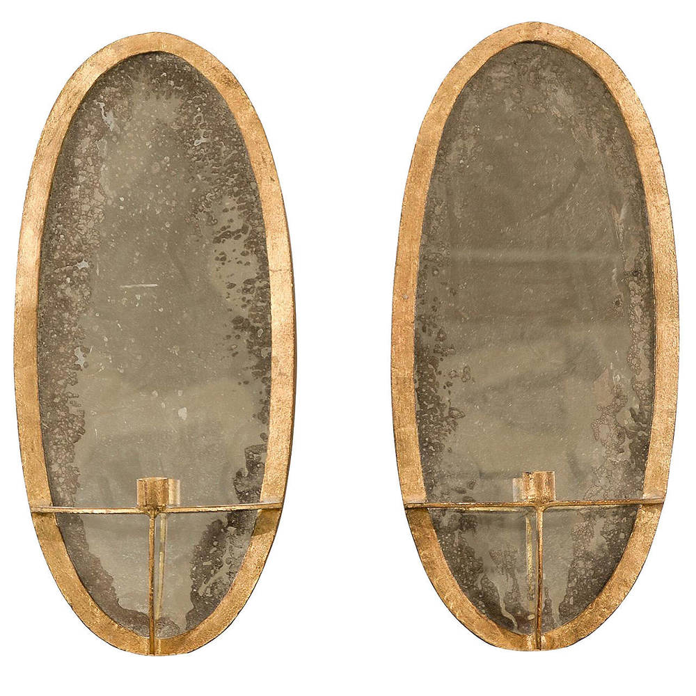 Pair of Oval gilt Iron Sconces with Mirrored Backs