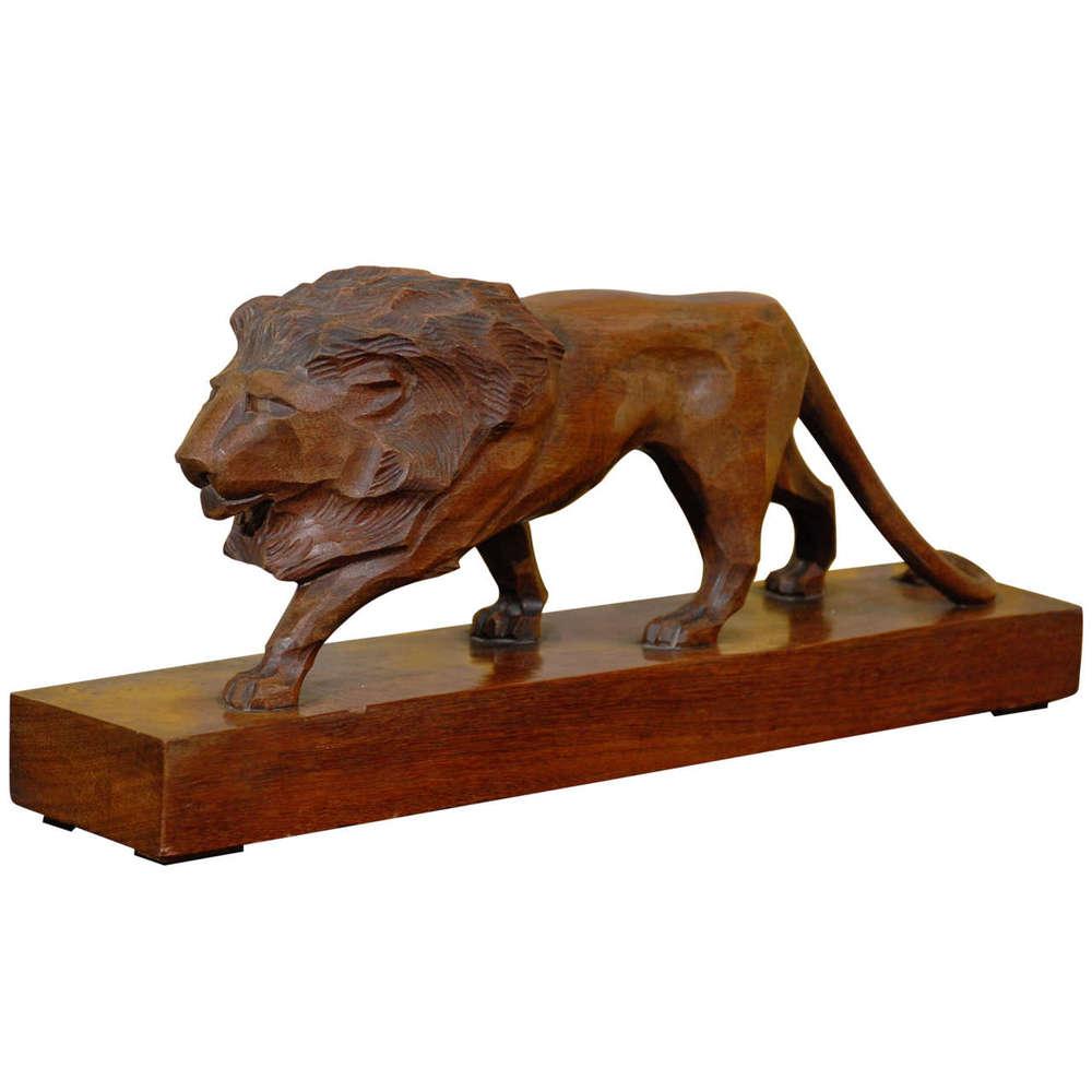 Carved Lion on Wood Base