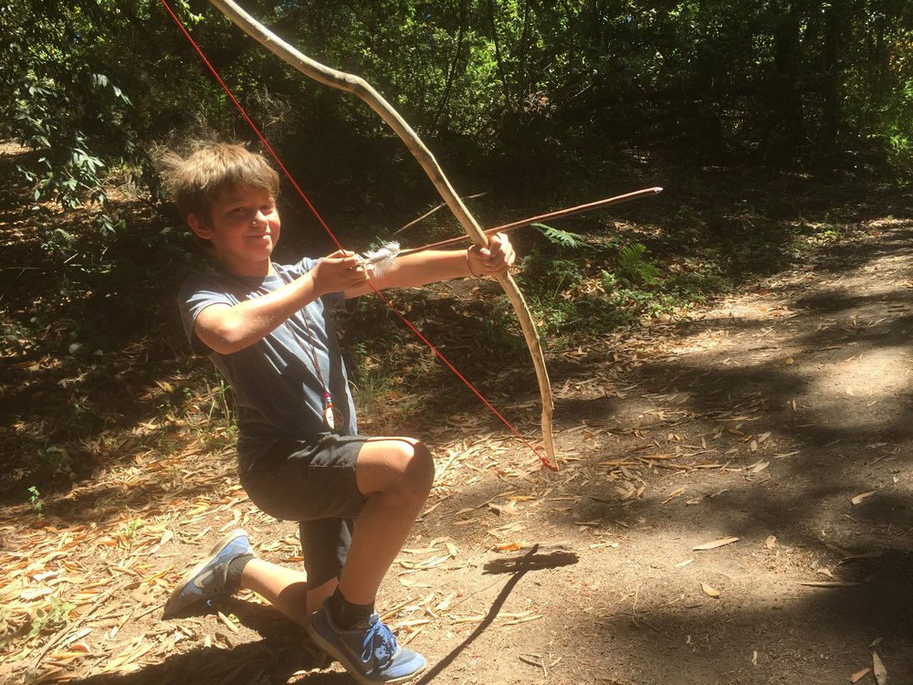 May 14, 2018 PRIMITIVE ARCHER:Use stone tools to make your own wildwood bow. Then learn arrowsmithing and how to tie real feather fletching onto your arrow. Students will also use a bow-drill to learn fire-by-friction.* - Students may repeat this class several times to make more advanced archery equipment with our teachers.