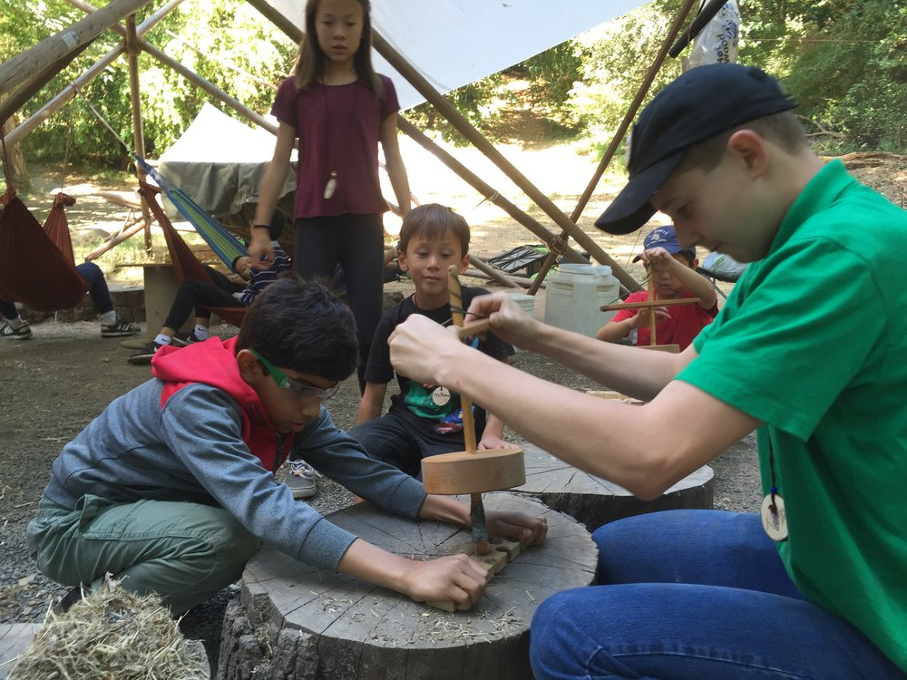 MAKER LABS at TWA:(May 7 and 21)Go to a day of school on Mondays at Tribal Wisdom Academy. Students work together to design projects that they make with our teacher. Students may bring home their smaller projects. Class is held outdoors, with a campfire and our kid-built forest shelters. -