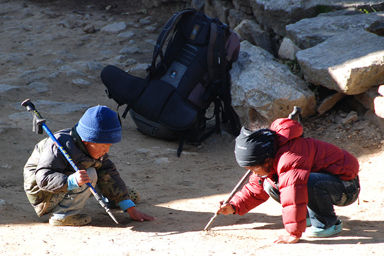 Sherpa boys with trekking pole