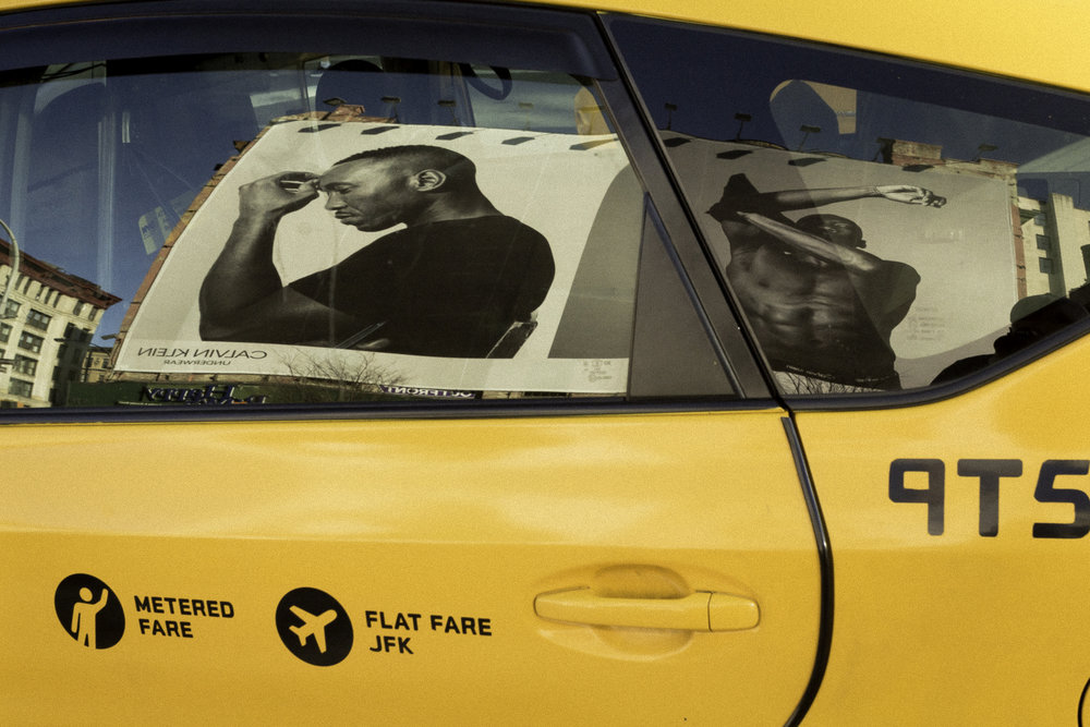 Calvin_Klein_Models_Reflected_in_Taxi.jpg