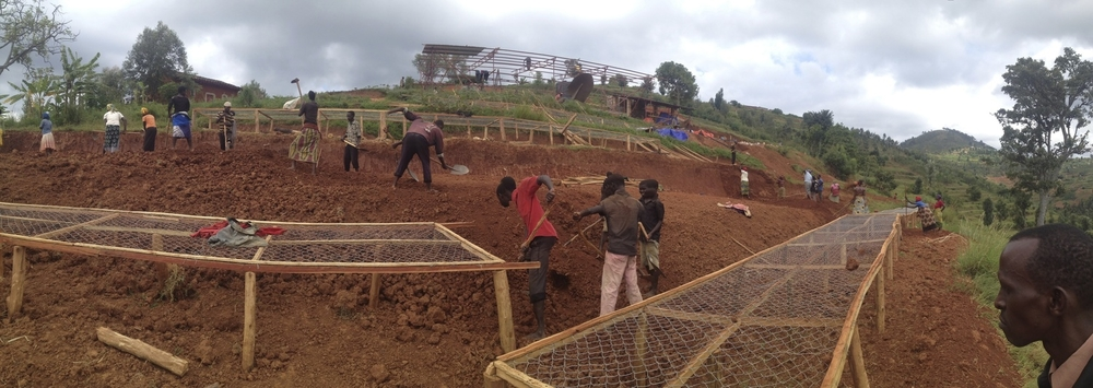 The local community being involved in the construction of the washing station. Spring 2013.