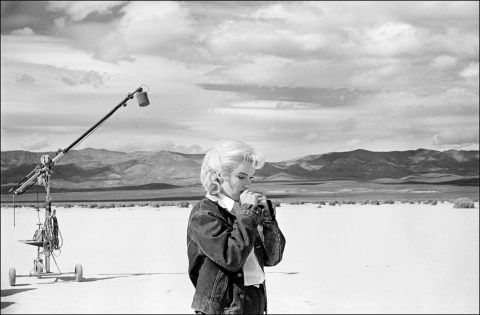 "USA. Nevada. US actress Marilyn Monroe on the Nevada desert going over her lines for a difficult scene she is about to play with Clarke Gable in the film ""The Misfits"" by John Huston, 1960 © Eve Arnold/Magnum Photos"