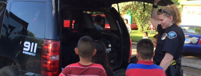 A Boulder police officer teaches kids about Squad Car safety.