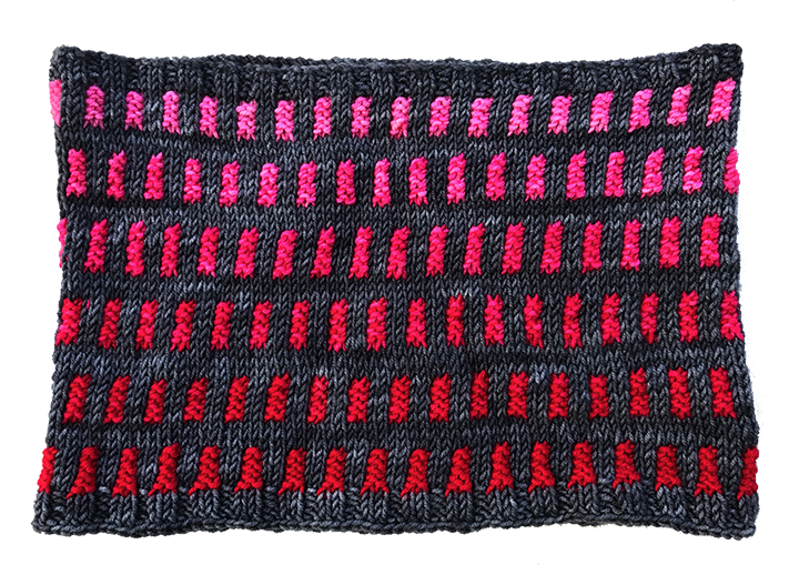 This cowl relies on the most saturated Fuchsia to make it yell happiness across a wintry scene!