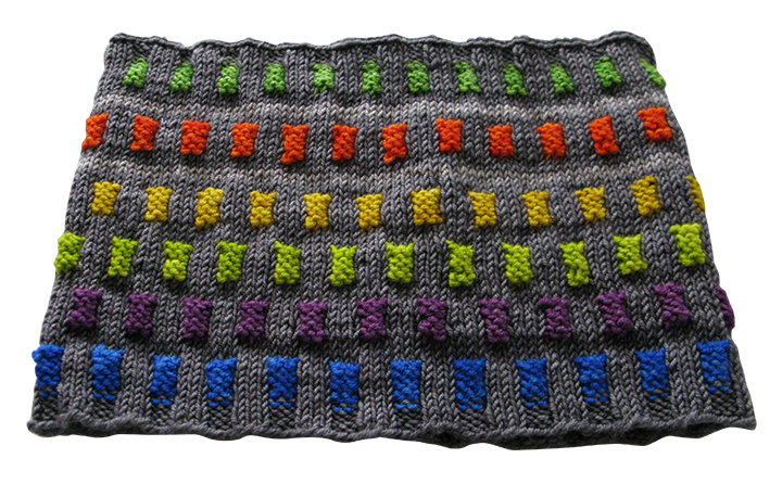 This cowl also features the background color offset stripe, but instead of repeating some tabs, chooses all different colors to make a vibrant and happy