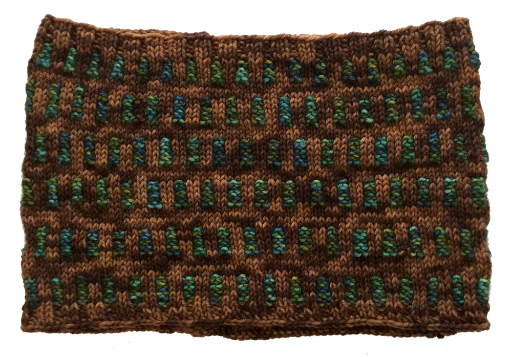 Here, a semi-solid background hosts a variegated yarn for the tabs, illustrating that if you can dream it up, you can probably do it with this pattern!
