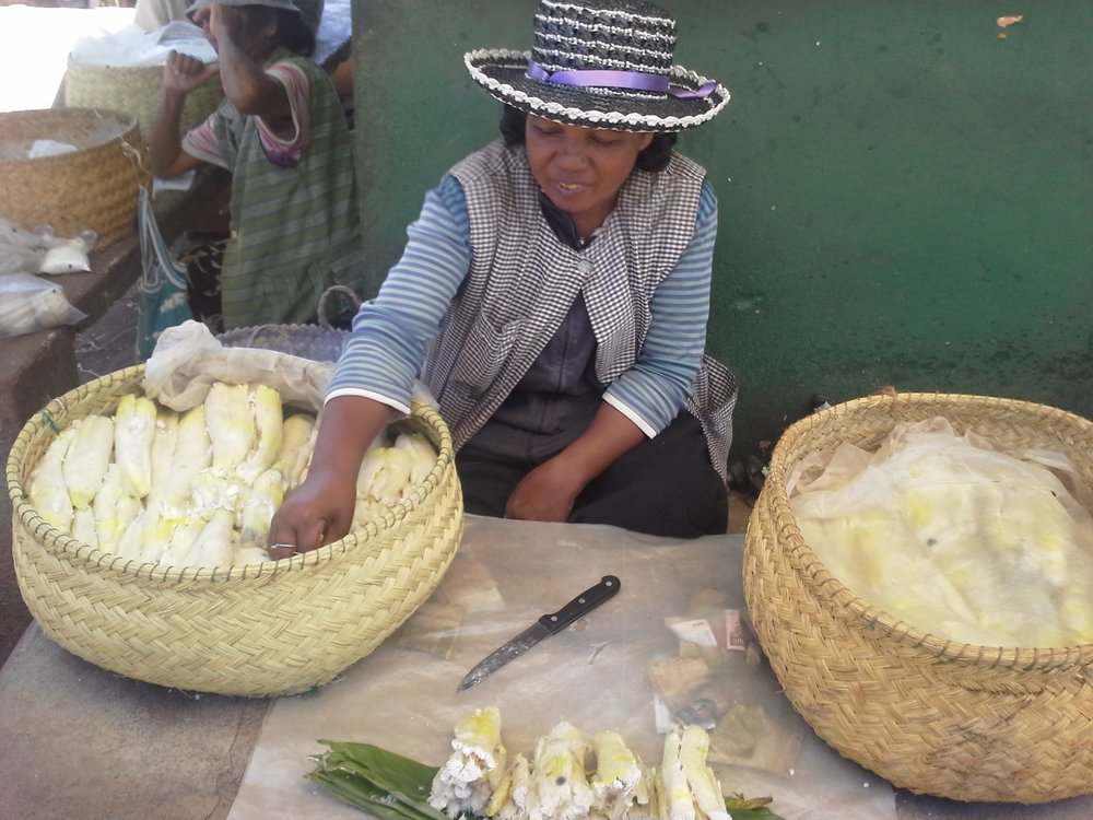 Manioc seller on market