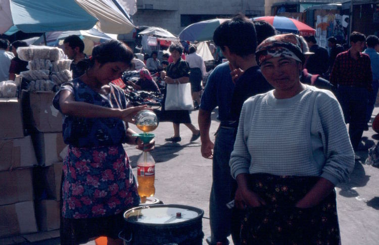 Decanting cooking oil into soda bottles, Osh Bazaar, Bishkek