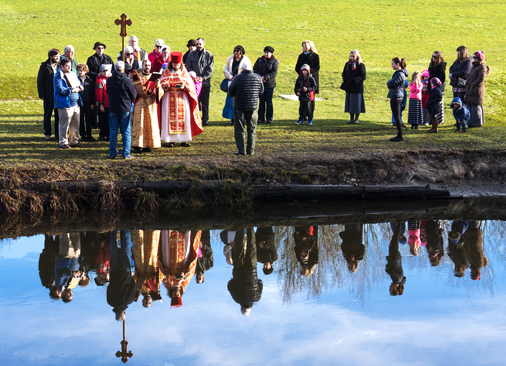 Parishioners from St. Katherine celebrate the Feast of the THeophany by blessing the waters of a park in nearby Woodinville.  Photo: Patty Rebne