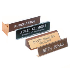 "Classic Name Plates  2"" x 8"" – with or without a logo   Reusable Name Plates  A multi-part system consisting of a metal back plate, a printed insert, and a desk holder or wall mount.   Acrylic Desk Blocks  Engraved on the front or back — each a very distinct look.   Executive Desk Wedges"