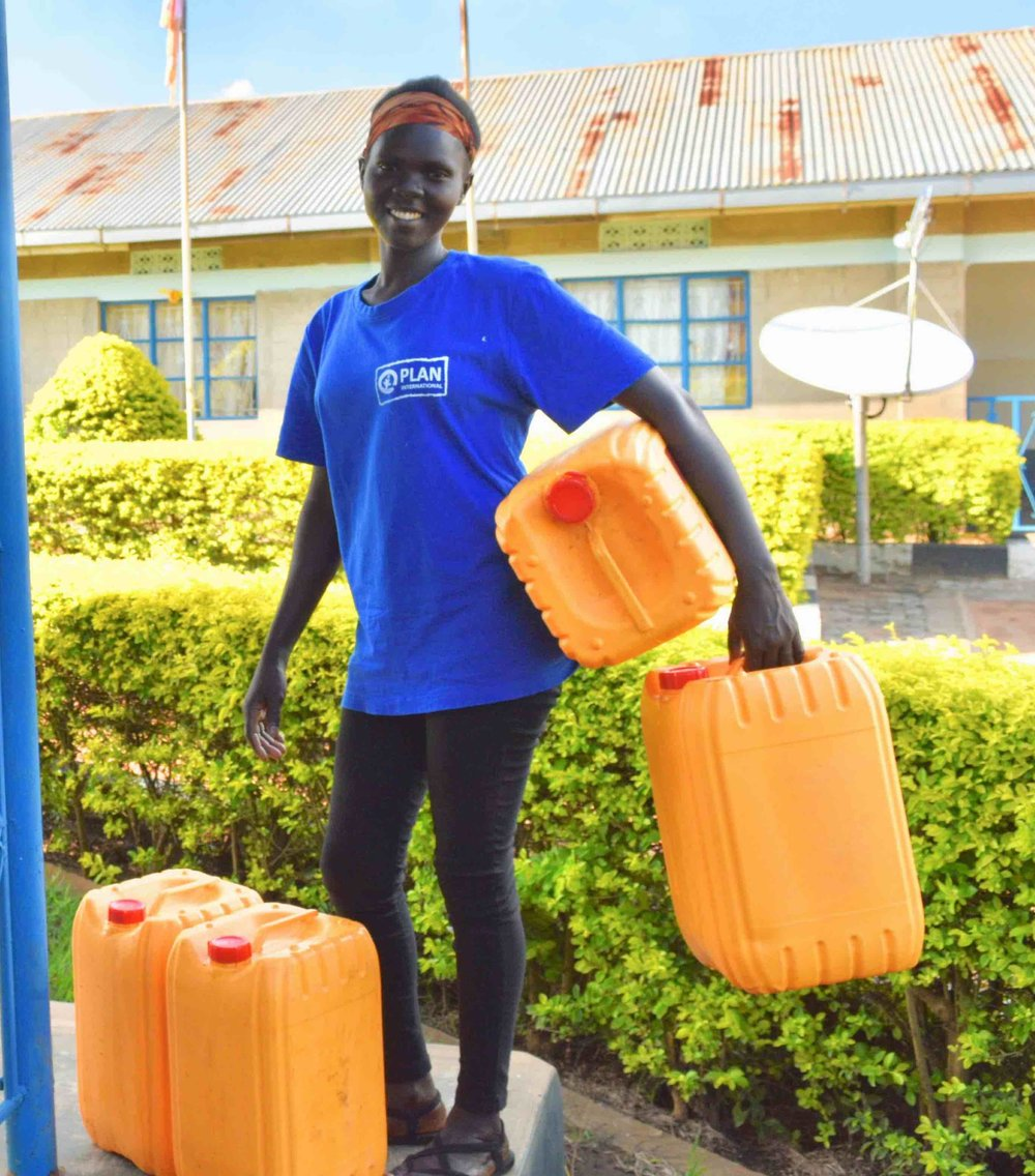 Joyce with her four new jerry cans