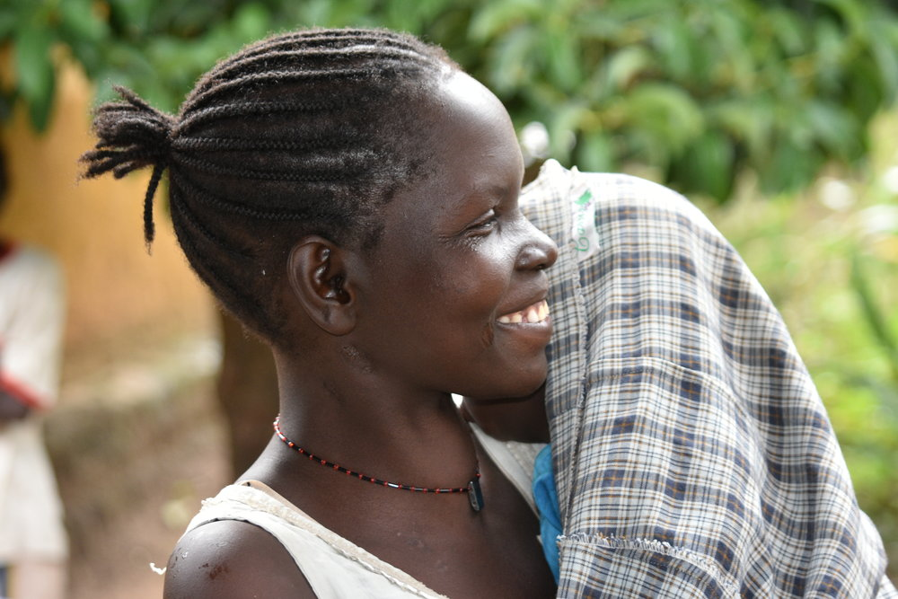 Joy is alone in raising her 7 children but she is determined. Clean water sure makes a difference.