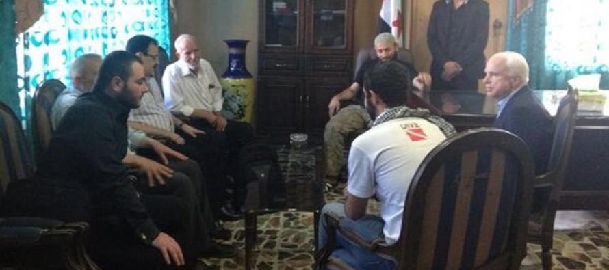 Image of US Senator, Jon Mccain, meeting with ISIS leader Abu Bakr and Syrian Rebels.