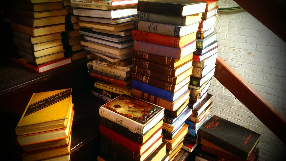 A small load of books in the middle of being sorted by floor.