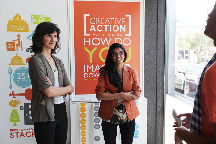 Winners from Houston speak with organizer Phanat Xanamane.