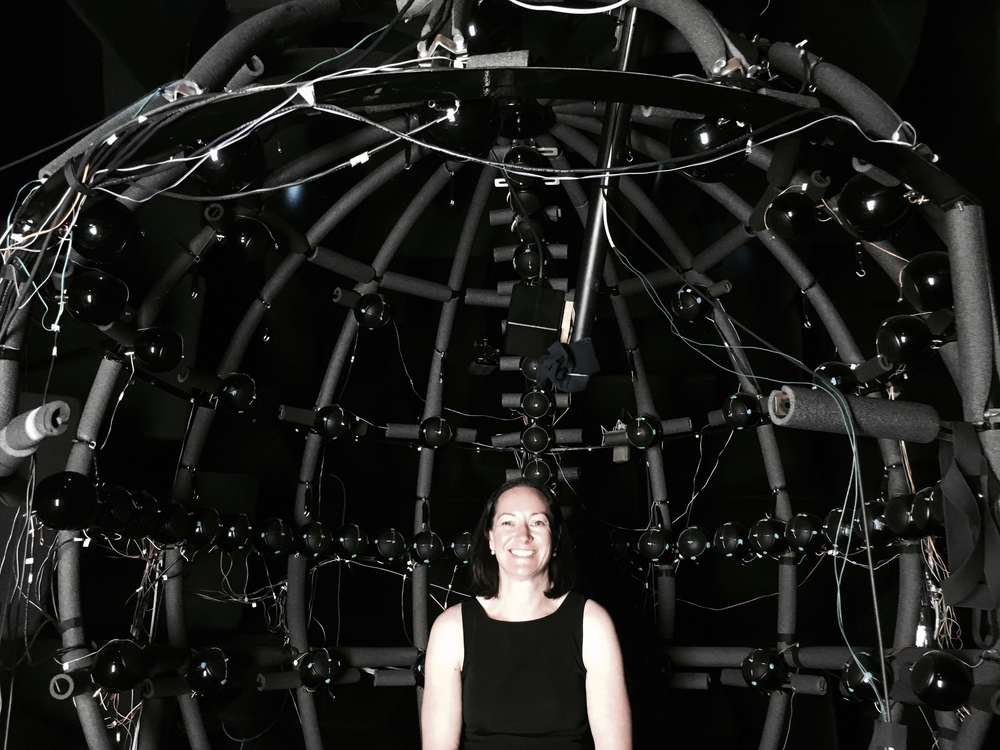 Anita experiencing The Dome technology for measuring movement and sound connections at BRAMS Lab Montreal