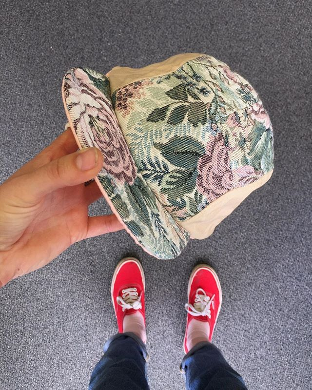 This hat didn't even make it out of the studio before someone snagged it. I had just enough of this floral textile to make one dope hat. What a lucky lady. . . . . .  #paulaluciastudio #artistsoninstagram #handmade #5panel #upholstery #recycledfabric #memade #repurpose #luckylady #textileartist #hat #sold #floralfabric #vansshoes