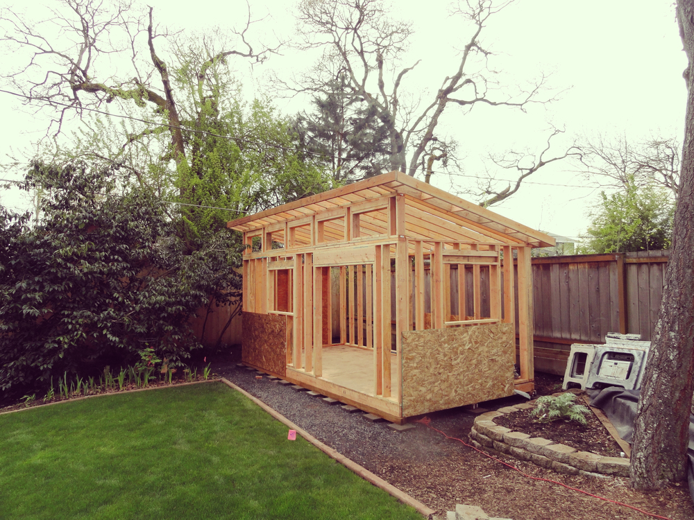 framing is performed with a strict adherence to residential building code walls are made from 2 by 6 lumber metal tie downs are in place - Tiny House Framing 2