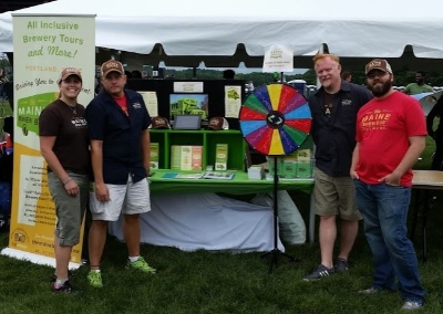Our Road Team with our display at an outdoor festival last year.