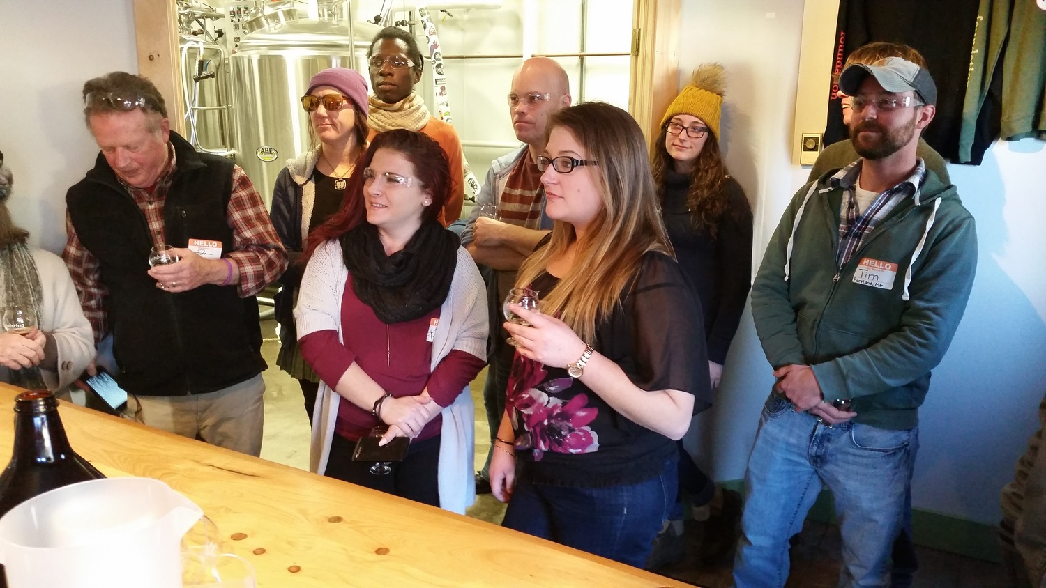 The Andy's group listens to Foundation Brewing's Adam Stein describe the company and the beers.