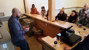 John LeGassey describes the build-out of the facility as the group samples John Henry Milk Stout,one of the three beers that are currently on tap.