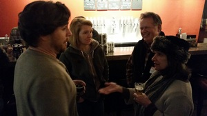At Rising Tide, Heather and Nathan Sanborn enjoy a beer with Rick and Jen of Andy's. Rising Tide beers sell very well at the pub, with often two draft lines dedicated to the five year old Portland brewery.