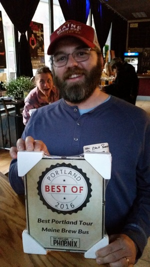 Our founder Zach shows off the award plaque.