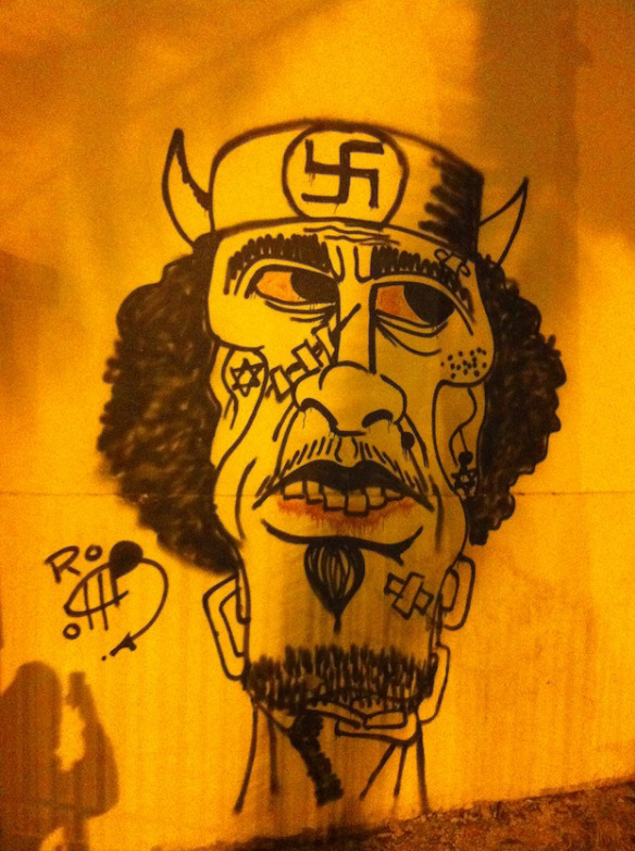 Graffito of ex-Libyan president Muammar Gaddafi painted by rebels in Tripoli. (2011, Thought Catalog)