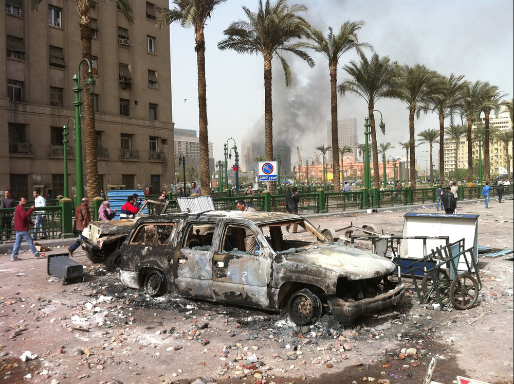 Torched cars litter Cairo's Tahrir Square after Egyptian protesters take to the streets in what would become the first night of the January 25th Revolution. (2011,  New York Post )