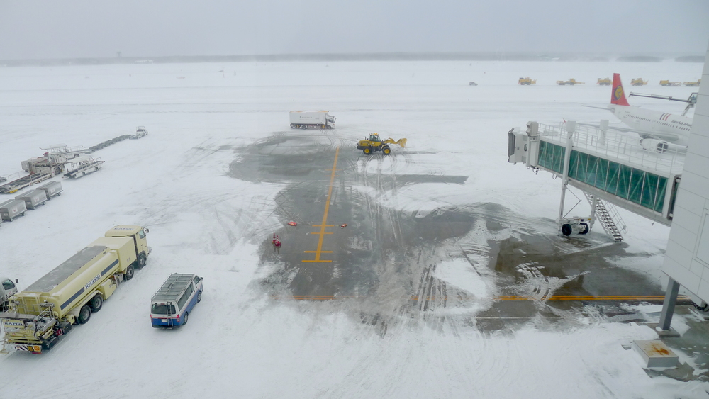 Ground crews at New Chitose Airport near Sapporo work to clear the runway after record-breaking snowfall in Hokkaido Prefecture, Japan; one of the world's snowiest territories. (2015)