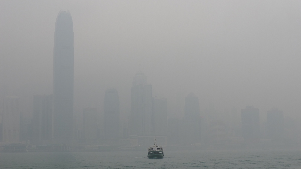 A passenger ferry crosses Kowloon Bay on an especially polluted afternoon in Hong Kong. (2015)