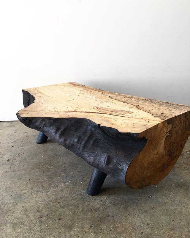 Natural slab coffee table with a burnt edge finish.
