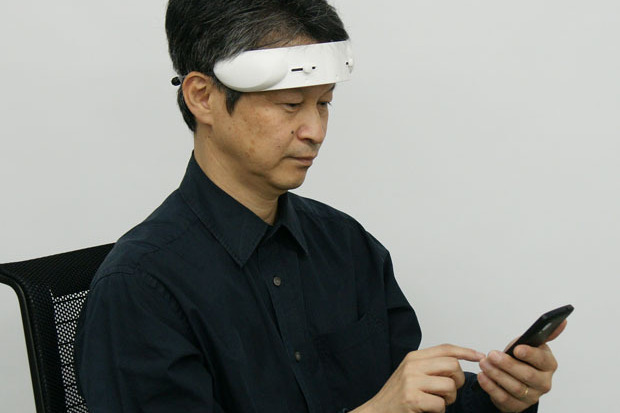"The article showcasing this product reads ""Distracted? Slap this Hitachi gizmo on your forehead to focus"". I can think of several ways to increase focus, ""slapping"" this cumbersome head visor on is not one of them. I would find this incredible distracting."