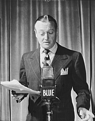 Edmund Lowe using a ribbon microphone